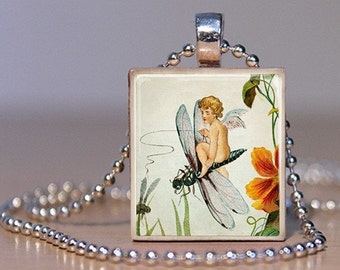 Vintage illustration of a child Fairy flying on a Dragonfly- Pendant or Lapel Pin made from an Upcycled Scrabble Tile (87E2)