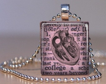 Vintage Image of Human Heart Anatomy on a Dictionary background made into a Pendant or Lapel Pin on an Upcycled Scrabble Tile (130C6)