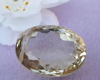 Stunning lemon quartz faceted focal bead in an oval shape