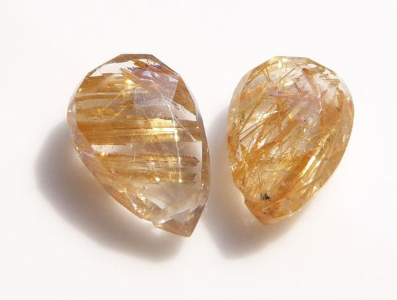 Pair of gold rutilated quartz faceted beads