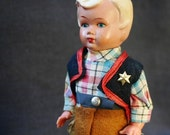 There's a new Sheriff in town. Vintage automaton doll.