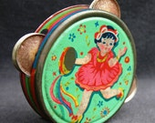 Fun colorful tambourine. Vintage collectible toy.