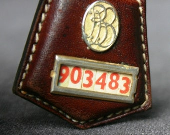 Another secret code. Maybe. Vintage numbered leather charm.