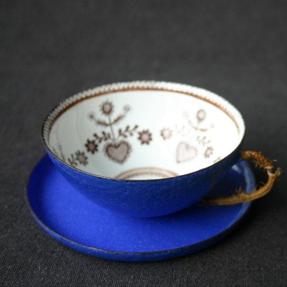 Beautiful blue enamel cup.