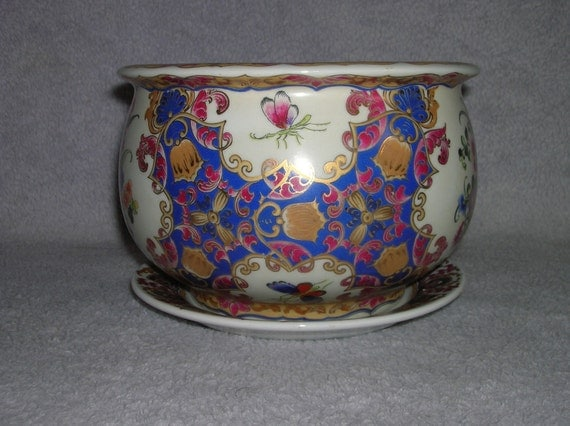 Ornate painted porcelain planter with saucer