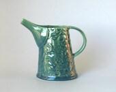 Small ceramic jug with Australian flannel flower design