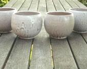 Four stoneware ceramic white bowls