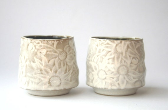 Pair of white and fawn teacups with Australian Flannel Flower design