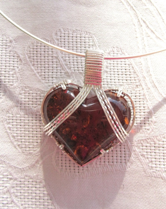 brown  Baltic Amber Heart Pendant, wirewrapped  in Argentum Sterlingsilver wire