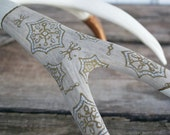 Ornate painted antler in gold, bronze, and white with delicate details