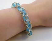 Sterling Silver Bracelet with Blue Donuts