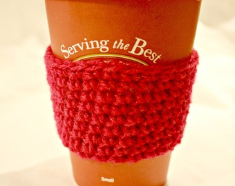 Bright pink crocheted cofee cup cozy