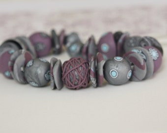 Elegant beaded necklace in silver-gray and plum