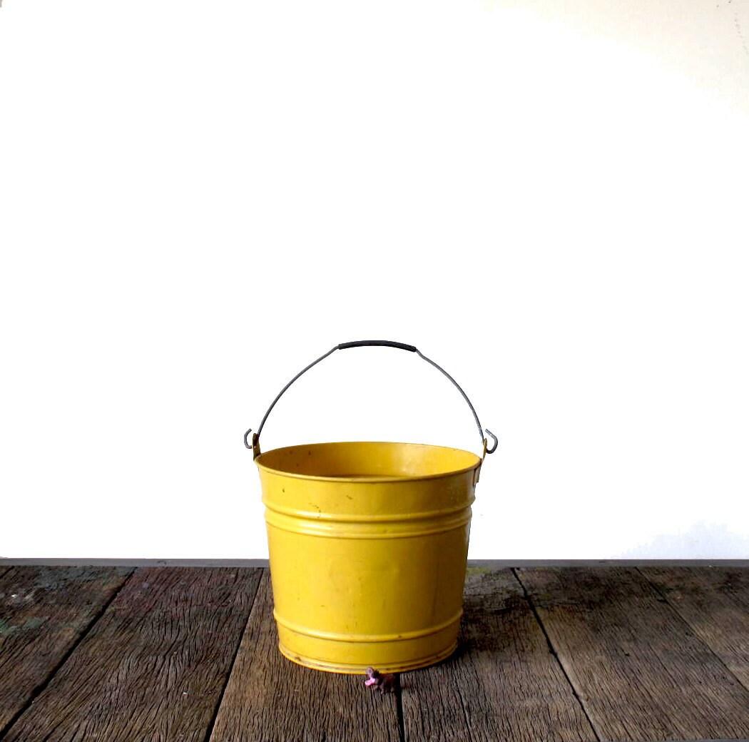 Vintage yellow metal bucket for Old metal buckets