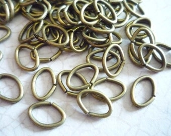 Antiqued Gold/Brass Color Oval Jump Rings 18 gauge 8 X 6mm - Qty 88 pieces