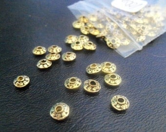 100 Pcs. 7MM Goldtone Round Scrolled Spacer Beads