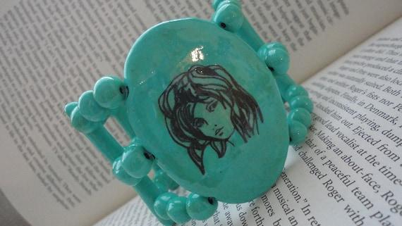 Handmade turquoise colored beautiful face bracelet