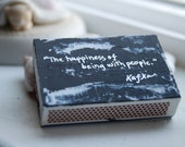 The Happiness of Being With People Matchbox