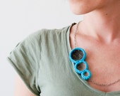 Crochet circles necklace with fabrics. Turquoise.