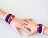 Crocheted bracelet of wool & button. FOR GIRLS. Pink, lilac and purple.