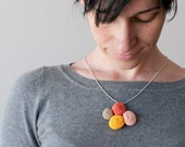 Crochet necklace. Reversible. Yellow, orange, salmon and beige .