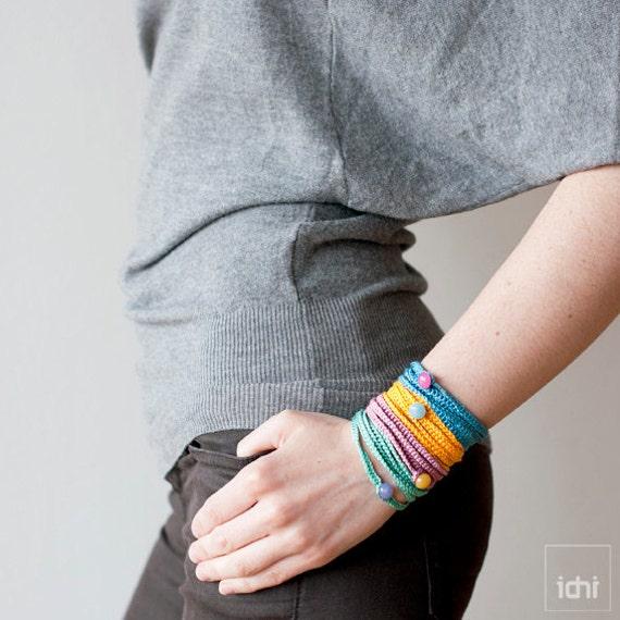 Crochet Bracelet . Blue with pink button .