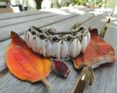 Black eyes Queer as Folk inspired Cowy Shell Bracelet