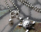 Playful Turtle and Pearl Necklace