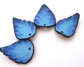 Set of 4 pcs blue leather leaves