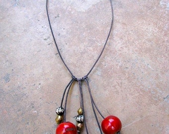 Handmade Faded Black Leather Necklace Strung with Large Round Red Coral Beads and African Brass and Tibetan Prayer Beads
