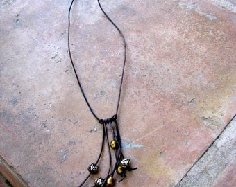 SALE!!! Faded Black Leather Necklace Strung with African Brass and Tibetan Prayer Beads