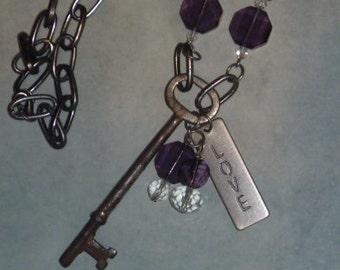 Vintage skeleton key, purple beads and love charm