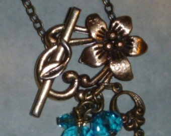 Front toggle flower necklace with aqua blue crystal beads