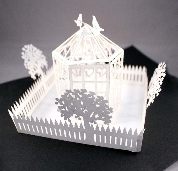 2 x popup card with birdcage and picket fence