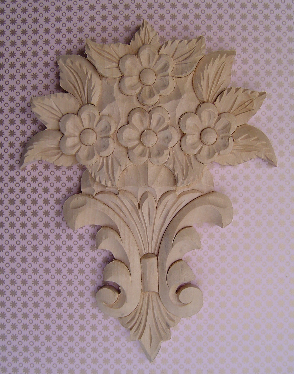 Unfinished flower wood carving