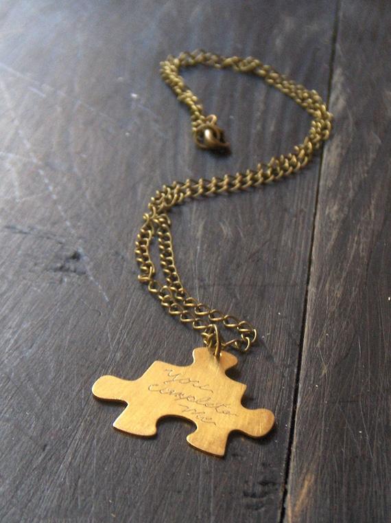 SweeT SaLe . You complete me.  Golden brass puzzle piece necklace. Unisex