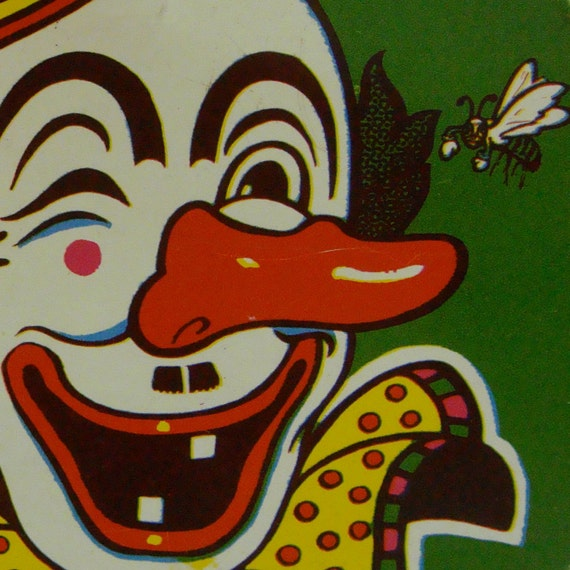 Vintage Ratchet Noisemaker Big Red Nose Snaggletoothed Clown Colorful Lithographed