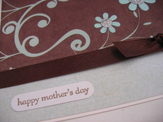 Mother's Day Glitter card with flowers and scrolls in blue and brown