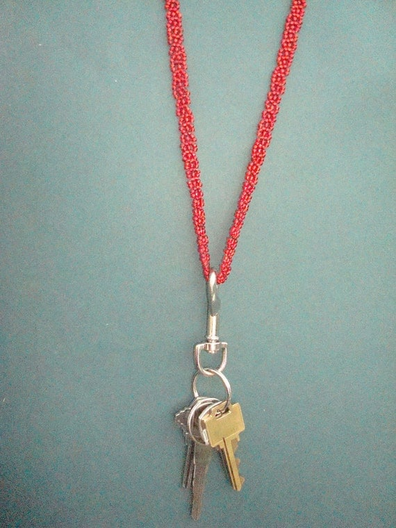 Heavy-duty red lanyard necklace - wear your badge or keys with style.