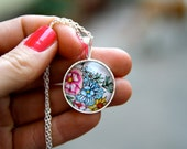 Silver plated glass pendent necklace, floral design