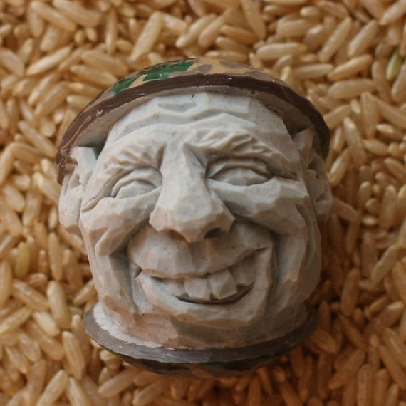 Hand Carved Camouflage Caricature Golf Ball