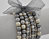 Lovely Angel------Very Unique Bridal wedding multi row Pearl Stretch Bracelet -------Receive a Beautiful GIFT, when...........................%20 discount for a limited time....Coupon code ( HelloSpring11).