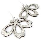 Metallic silver laser cut leather earrings