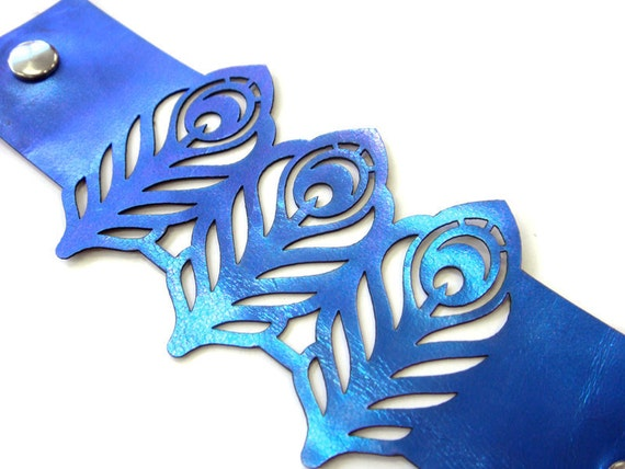 Laser cut peacock feather leather cuff bracelet in metallic blue