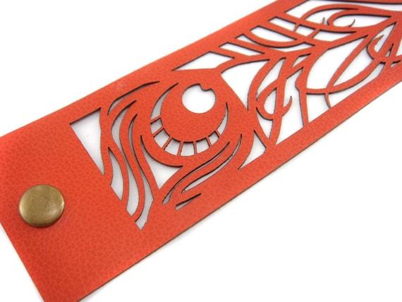 Laser cut peacock feather leather cuff bracelet in orange