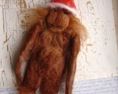 Big Foot art doll.Needle felted with removeable santa hat