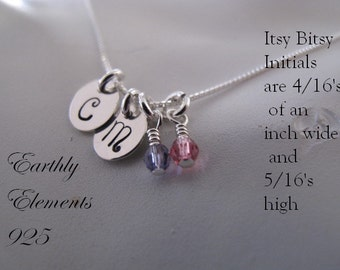 A Duo of Itsy Bitsy initial charms in Sterling Silver