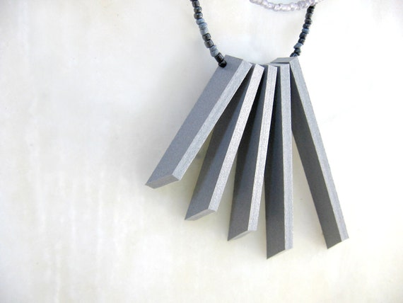 geometric double-strand necklace with grey sticks and beads