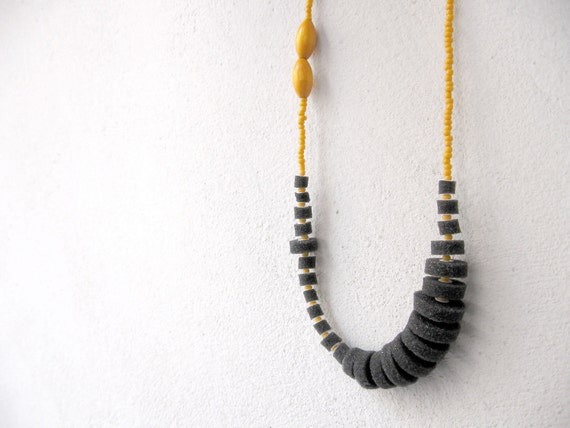 geometric long necklace with dark grey circles and mustard yellow beads