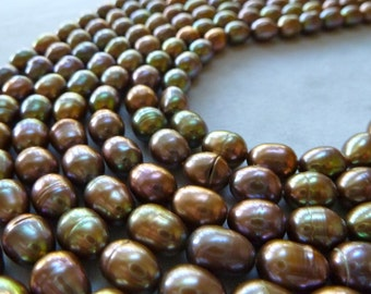 Brown Peacock Rice Pearls - shades of lustrous gold , green, pink - 8mm - 1/2 strand